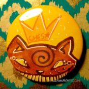 Tabby on Yellow Teary Ches Star Button